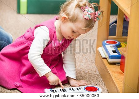 Little Child Girl Playing In Kindergarten In Montessori Preschool Class.