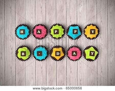 Happy Birthday Cupcakes On Wood Floor Background