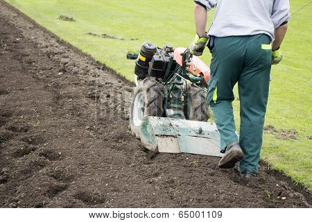 Man With Rototiller