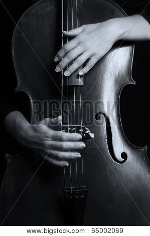 Beautiful Woman Holding A Cello With Selective Light And Black Dress Artistic Conversion