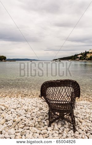 Chair On A Beach Covered With Pebbles
