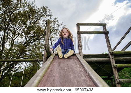 Young Girl And Wooden Teeter Board