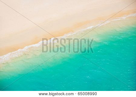 Beach and Sea. Aerial view from helicopter of tropical ocean meeting the sand