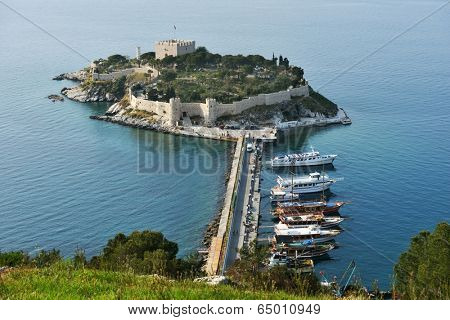 KUSADASI, TURKEY - APRIL 7, 2014: View to the castle on Pigeon island. Built in Byzantine Era, now the castle houses the museum and is the lovely place for many tourists