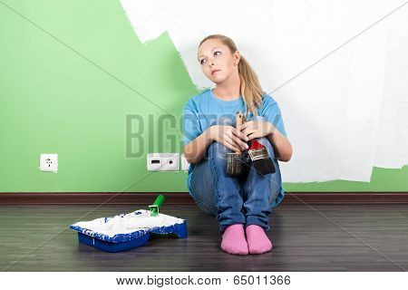 Unhappy Woman With Paint Tools
