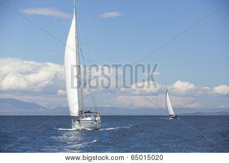 AEGEAN SEA, GREECE - MAY 5, 2014: Unidentified sailboats participate in sailing regatta