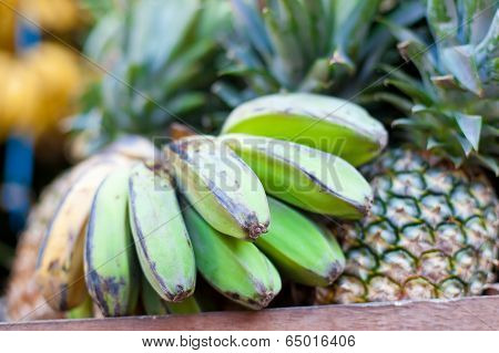 Bananas And Pineapple On Market