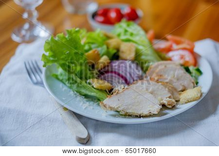 Chicken Salad With Tomatoes In The Background On Wood Table