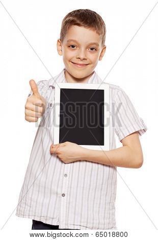 Child with a tablet pc. Boy playing on tablet isolated on white background