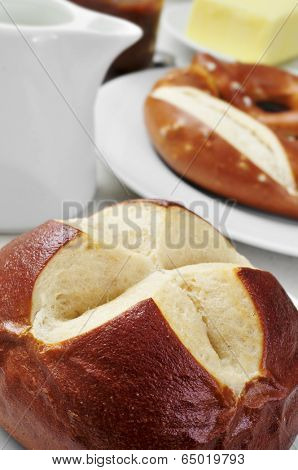 closeup of a german lyre roll on a set table for breakfast