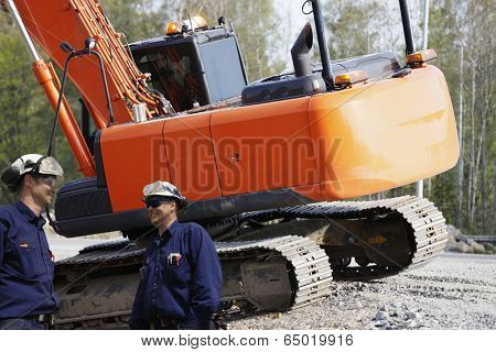two engineers inside building industry, bulldozer, digger in action