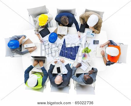 Group of Engineers planning in a Meeting