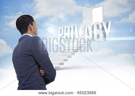 The word privacy and unsmiling asian businessman with arms crossed against steps leading to open door in the sky