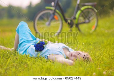 Beautiful Young Woman Outdoors. Calm Relaxing Girl On Green Grass