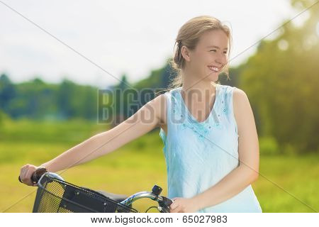 Happy Beautiful Blond Woman Having Good Time With Bicycle Outdoors