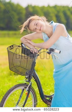 Happy Smiling Caucasian Blond With Bicycle In The Park