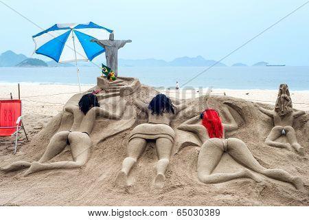 Sand sculpture sunbathe on the beach of Copacabana