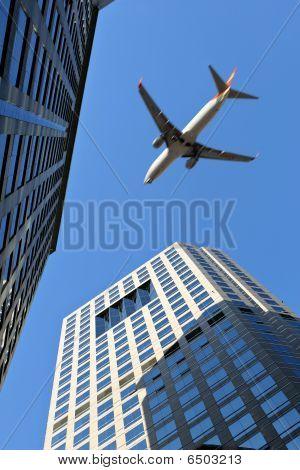 beijing: airplane flying over modern buildings