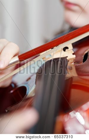 Child Plays On Fiddle By Bow