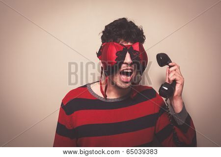 Man With Bra On Face Answering Telephone