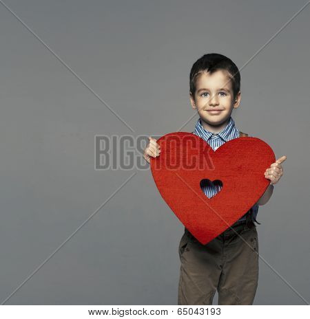 Portrait Of A Small Boy Presenting Heart