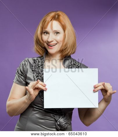 Beautiful Woman With A Blank (paper) For Your Text