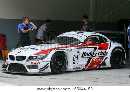 SEPANG, MALAYSIA - MAY 10, 2014: The BMW car of Jun San Chen and Ollie Millroy leaves to start the free practice session of the Malaysian Super Series Round 2 in Sepang International Circuit.