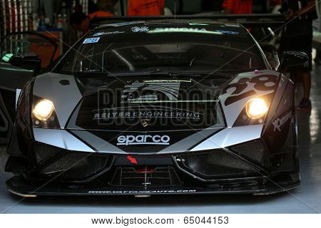 SEPANG, MALAYSIA - MAY 10, 2014: The Lamborghini LP600 car of Chonsawat Asavahame prepares to leave the garage during the GT3 race of the Thailand Super Series Rd 1 in Sepang International Circuit.