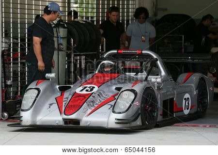 SEPANG, MALAYSIA - MAY 10, 2014: The race car of Natasha Seatter prepares to start the free practice session of the Malaysian Super Series Round 2 in Sepang International Circuit.
