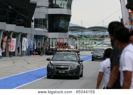 SEPANG, MALAYSIA - MAY 10, 2014: The official Safety Car enters the pit lane at the end of the free practice session of the Malaysian Super Series Round 2 in Sepang International Circuit.