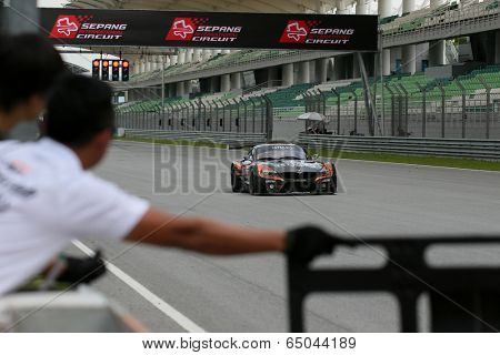 SEPANG, MALAYSIA - MAY 10, 2014: The BMW car of Morris Chen and Tatsuya Tanigawa races down the straight at the free practice session of the Malaysian Super Series Round 2 in Sepang Circuit.