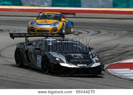 SEPANG, MALAYSIA - MAY 10, 2014:The Lamborghini LP600 car of Chonsawat Asavahame takes to the track at the Thailand Supercar GT3 race of the Thailand Super Series Rd 1 in Sepang International Circuit.