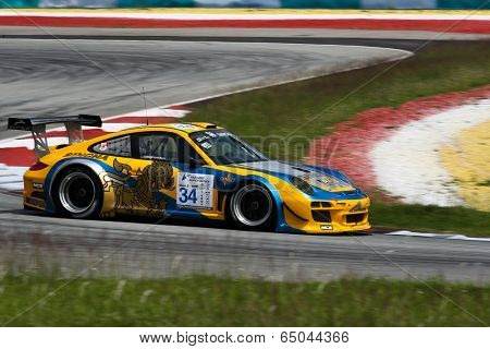 SEPANG, MALAYSIA - MAY 10, 2014: The Porsche car of Kantasak Kusiri takes to the track at the Thailand Supercar GTM race of the Thailand Super Series Rd 1 in Sepang International Circuit.