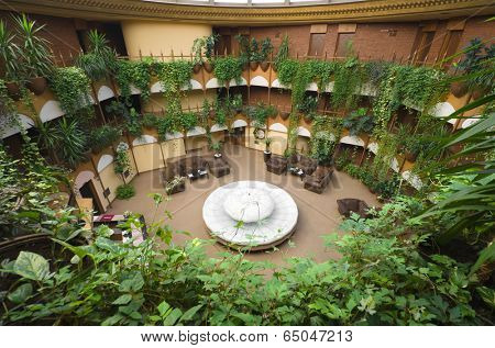 NOVI PAZAR, SERBIA - JULY 26: the circular hall of the hotel Vrbak, the most grandiose of the former Yugoslavia, is similar to a greenhouse. Shot in 2013