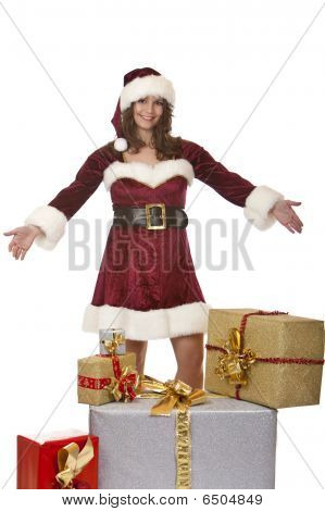 Young Santa Claus Woman Presenting Christmas Gift Boxes