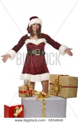 Young Santa Claus Woman Presenting Christmas Gift Boxes