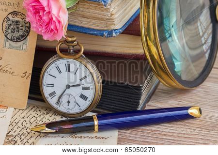antique clock on old  books and letters background