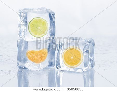 Ice cubes with fruits on light background