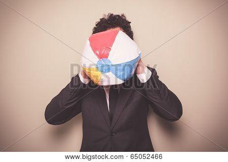 Businessman Blowing Up A Beach Ball