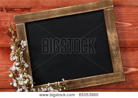 Old vintage school slate with flowers