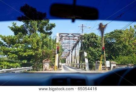 View of the small bridge with serial movement from a car window. Jamaica.
