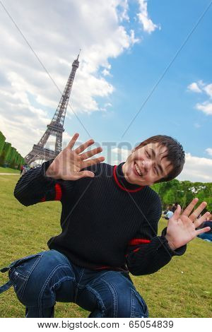 Smiling Boy In Front Of The Eiffel Tower (la Tour Eiffel) In Paris