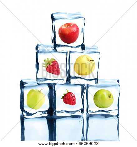 Ice cubes with fruits and berries isolated on white