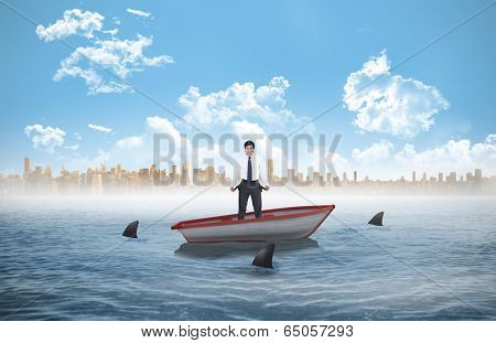 Sad tradesman showing his empty pockets against sharks circling a small boat in the sea