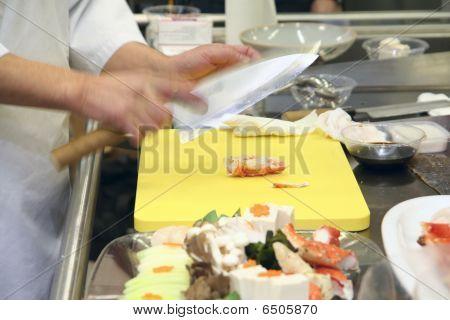 Chef Cooking On  Restaurant Kitchen