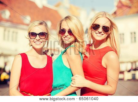 holidays and tourism, friends, hen party, blonde girls concept - three beautiful women in the city