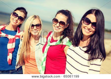 summer, holidays, vacation, happy people concept - beautiful teenage girls or young women having fun on the beach