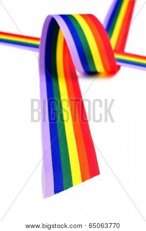 closeup of a rainbow ribbon on a white background
