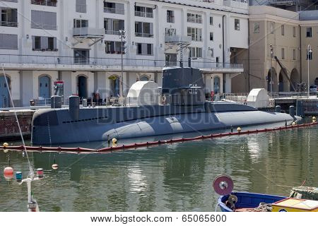 GENOA, ITALY - JUNE 16, 2012: Italian Navy Nazario Sauro class submarine converted to museum (Galata Sea Museum) in Genoa old port.