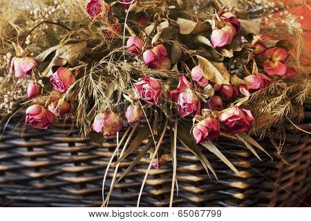 Arrangement Of Dried Roses In A Basket
